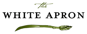 The White Apron logo.